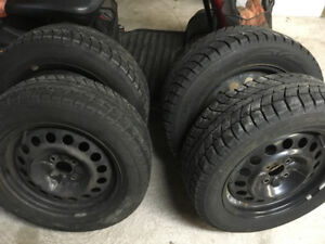 Set of 4 winter tires on 4x100 rims. 195/60r/15