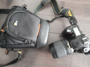 Nikon D90 Digital DSLR Camera with 18-105 mm Lense  Bag Included