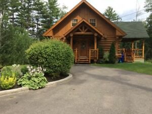 Beautiful waterfront log cottage for rent - 45 min from Gatineau