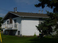 HIGHLAND GREEN 4 PLEX FOR SALE IN RED DEER, AB