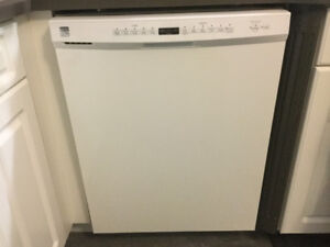 Kenmore Fridge stove dishwasher and hood range microwave.