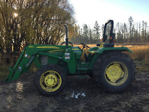 5075 John Deere Tractor with bucket and forks