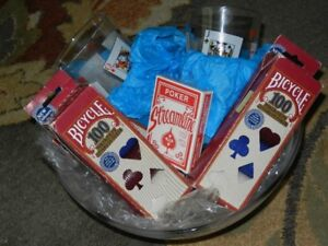 Poker chips ,  cards glasses and munchies bowl