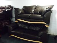 As new 3 and 2 brown leather sofa with wood trim