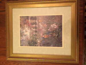 Painting of a garden in a gold coloured frame