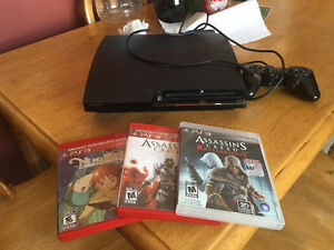 PS3 console with a few games