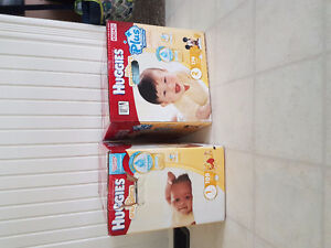 Size 1 and 2 huggies unopened 174 count and 198 count