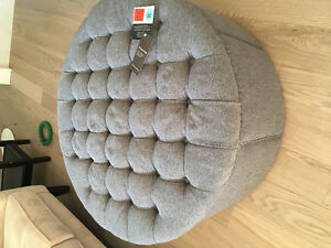 Never used upholstered ottoman