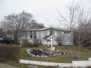 Spacious one of a kind mobile home in Evergreen with large lot