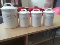 Biscuit, sugar, tea and coffee containers