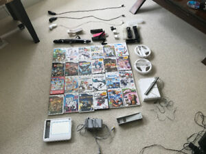 Wii and accessories with 24 games