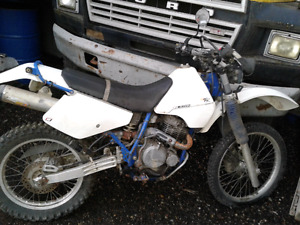 Black and white DR 350cc  duel sport