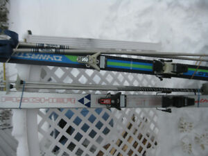 2 Pair  of Fiberglass Down Hill Ski and Poles $25.00 per pair