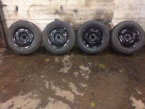 225/60/16  SNOW TIRES FROM IMPALA ON RIMS