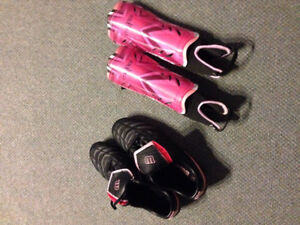 Like new, women's soccer cleats and shin guards