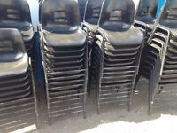 100 x Black stackable stacking chairs in plastic. Delivery.