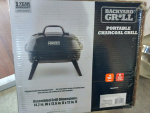 Backyard grill - portable charcoal grill.