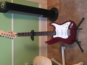 SQUIER ELECTRIC GUITAR COMES WITH STAND AND STRAP 200 OBO