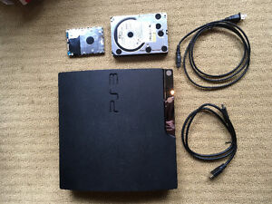 PS3 WITH 22 games, 2 extra hard drives, and 2 controllers.