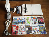 Wii, Fit board, 2 controllers + motion plus, nunchuks, 10 games