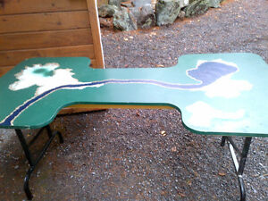 Folding table for child's train set