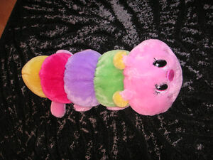 """Caterpillar cushion measures to be about 28"""" long $10.00  Beige"""