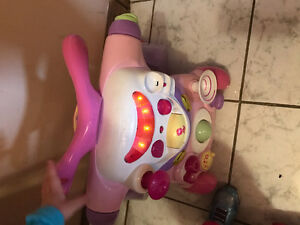 toy walker that plays music
