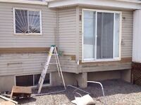 Siding and roofing repair services available.