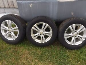 3 equinox rims with like new tires  London Ontario image 1