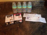 4 NUK bottles 5oz with coupons
