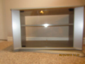 TV Stand -Swivel base front Glass Doors.