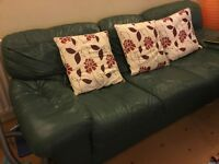 Two three seater green leather settees