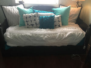 Black daybed with mattress and black dresser