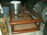 large square wooden coffee table with 4 squares of glass on top