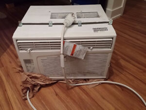 Garrison Window AC with unused foam panels.