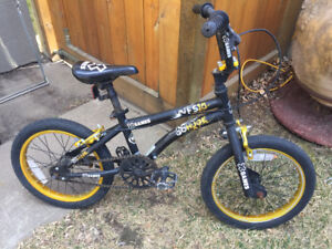 """Boys 16"""" bicycle. Comes with training wheels."""