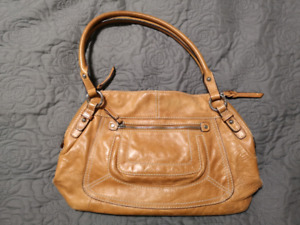 Light brown Danier leather purse. Great condition!