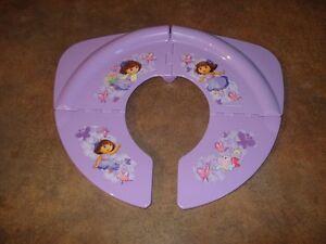 Siège de toilette pliable de voyage Dora.