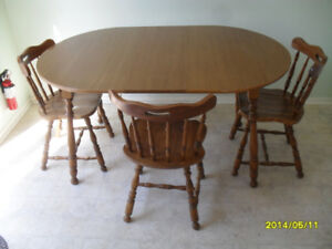 "Wood round table and 3 chairs, table measures 40"" diameter"