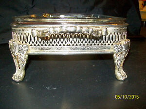 Silver plated ornate frame with glass casserole dish