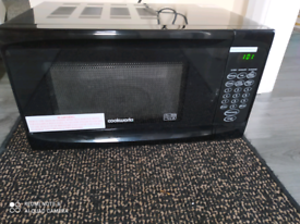 Cookerworks microwave used delicately black colour