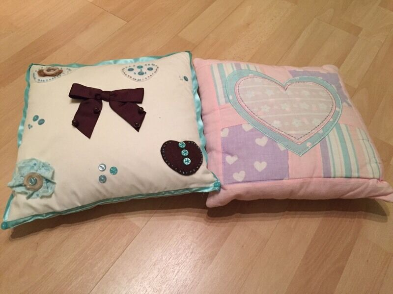 Two original style cushions ideal for a girls room, pet and smoking free