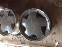 Four black rims for a Chevy truck, year 1999 or older