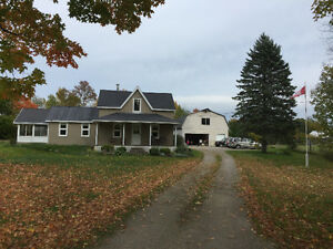 Large country home with large garage plus potential retail space