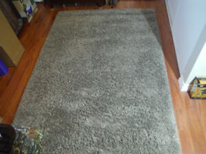 Brown Rug (Costco) 5 1/2 feet by 7 1/2 feet