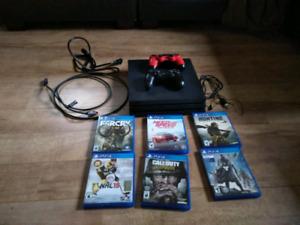 Playstation 4 pro 1000gb, 2 manettes et 6 jeux