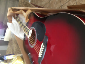 Très belle Guitare rouge neuf acoustique de qualité.