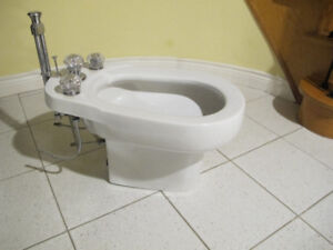 Bidet For Sale. White. Newer used. New Condition.