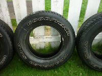 4 - 16IN. GOODYEAR WRANGLER SR-A AT M+S TIRES - P235/70R16 104S