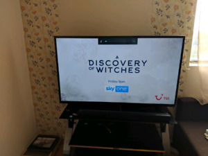 """55"""" Toshiba, LG sound bar, woofer and Tv stand for sale"""
